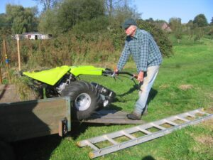 Richard unloads the mower on the Green