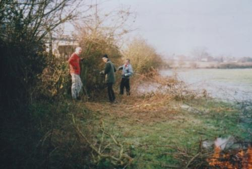 43. 2003 January cutting back the overgrown hedge before contractors planted more hedging to screen Industrial Site