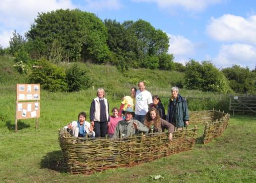 80. 2009 June Breathing Places Weekend volunteers in finished willow wherry