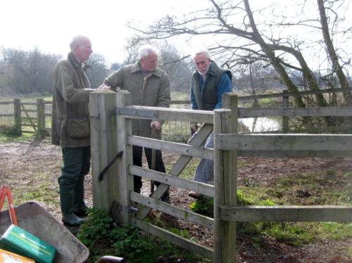 89. 2010 April Folly meadow Richard, Mike and Fred removing kissing gate by White bridge